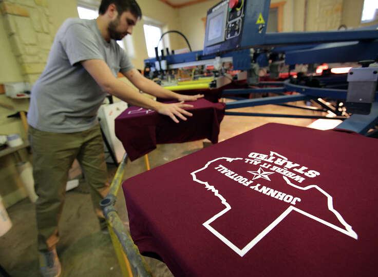 Scott Klingle prints shirts at BeBop T-Shirt Shop to be worn Saturday night during a celebration