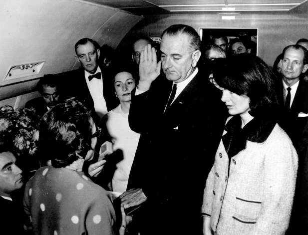 In this Nov. 22, 1963, file photo, provided by the White House, Lyndon B. Johnson is sworn in as President of the United States in the cabin of Air Force One as Jacqueline Kennedy stands at his side. Judge Sarah T. Hughes, a Kennedy appointee to the Federal court, left, administers the oath. In background, from left are, Jack Valenti, admistrative assistant to Johnson; Rep. Albert Thomas, D-Tex.; Mrs. Johnson; and Rep. Jack Brooks, D-Tex, at right behind Jacqueline Kennedy. Jack Brooks was in the Dallas motorcade Nov. 22, 1963, when President John F. Kennedy was assassinated. Brooks, a Democrat who spent 42 years representing his Southeast Texas district, has died at age 89. (AP Photo/White House, Cecil Stoughton, File) Photo: Cecil Stoughton, Associated Press / White House