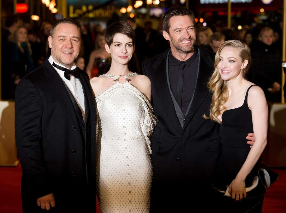 Russell Crowe (L) Anne Hathaway (2-L) Hugh Jackman (2-R) and Amanda Seyfried (R) pose for photographers on the red carpet ahead of the world premiere of Les Miserables in central London on December 5, 2012. AFP PHOTO/Leon Neal/Getty Images Photo: LEON NEAL, AFP/Getty Images / AFP