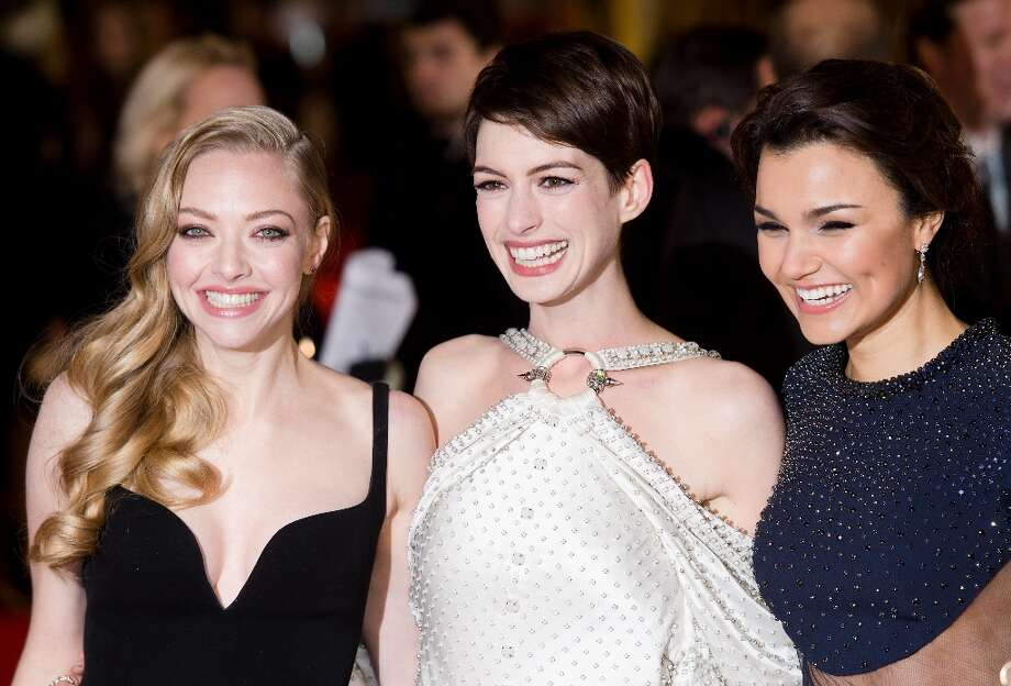 Amanda Seyfried (L), Anne Hathaway (C) and Samantha Barks (R) pose for photographers on the red carpet ahead of the world premiere of Les Miserables in central London on December 5, 2012. AFP PHOTO/Leon Neal/Getty Images Photo: LEON NEAL, AFP/Getty Images / AFP