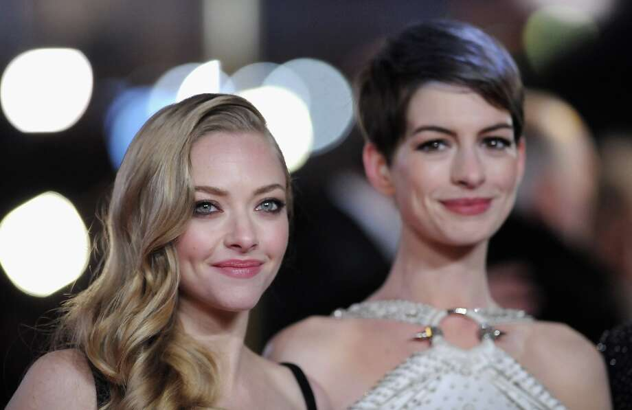 Actresses Amanda Seyfriend and Anne Hathaway attend the Les Miserables World Premiere at the Odeon Leicester Square on December 5, 2012 in London, England.  (Photo by Stuart Wilson/Getty Images) Photo: Stuart Wilson, Getty Images / 2012 Getty Images