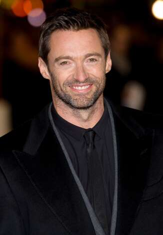 Australian actor Hugh Jackman poses for photographers on the red carpet ahead of the world premiere of Les Miserables in central London on December 5, 2012. AFP PHOTO/Leon Neal/Getty Images Photo: LEON NEAL, AFP/Getty Images / AFP