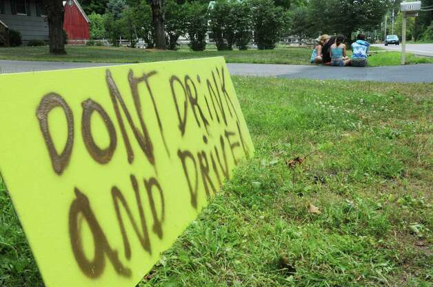 A neighbor posted a sign on Sunday, July 8, 2012, near the scene on West Milton Road where  14-year-old Kari Liedel was killed after she was struck by a drunken driver while walking down the road.  (Paul Buckowski / Times Union archive) Photo: Paul Buckowski / 00018387A
