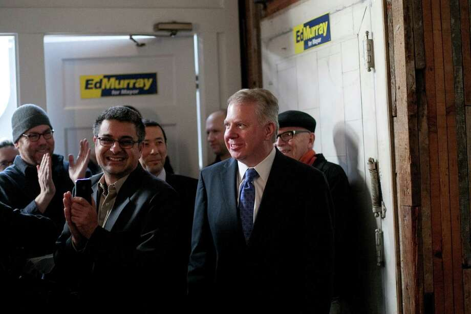 "Washington State Senator Ed Murray enters a room as he prepares to announce the possible launch of a campaign for Seattle Mayor on Wednesday, December 5, 2012 in Seattle's Capitol Hill neighborhood. Murray said that his campaign is still the the ""exploratory"" stages. Photo: JOSHUA TRUJILLO / SEATTLEPI.COM"