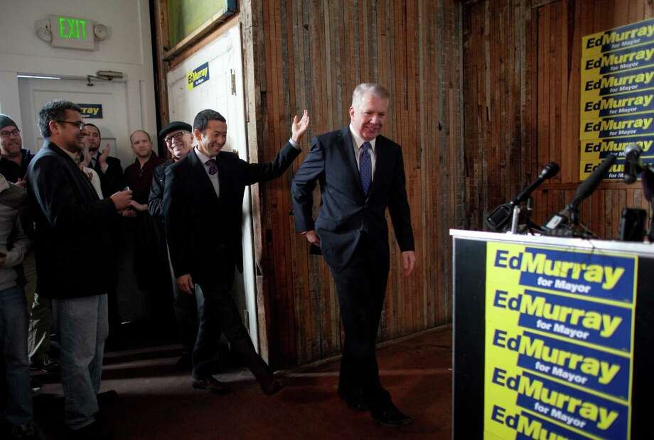 "Washington State Senator Ed Murray enters a room with his partner Michael Shiosaki as he prepares to announce the possible launch of a campaign for Seattle Mayor on Wednesday, December 5, 2012 in Seattle's Capitol Hill neighborhood. Murray said that his campaign is still the the ""exploratory"" stages. Photo: JOSHUA TRUJILLO / SEATTLEPI.COM"