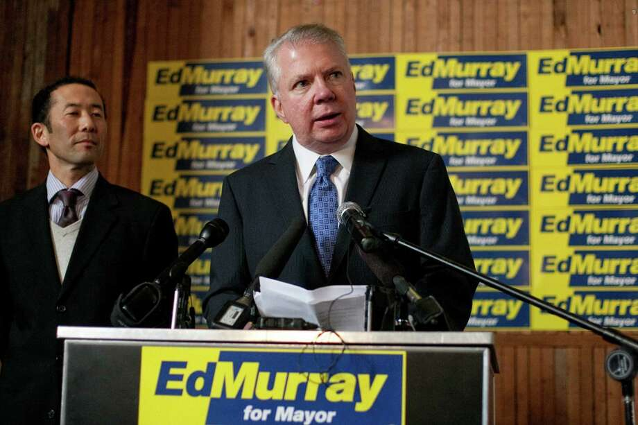 "Washington State Senator Ed Murray announces the possible launch of a campaign for Seattle Mayor as he stands at a podium with his partner Michael Shiosaki on Wednesday, December 5, 2012 in Seattle's Capitol Hill neighborhood. Murray said that his campaign is still the the ""exploratory"" stages. Photo: JOSHUA TRUJILLO / SEATTLEPI.COM"