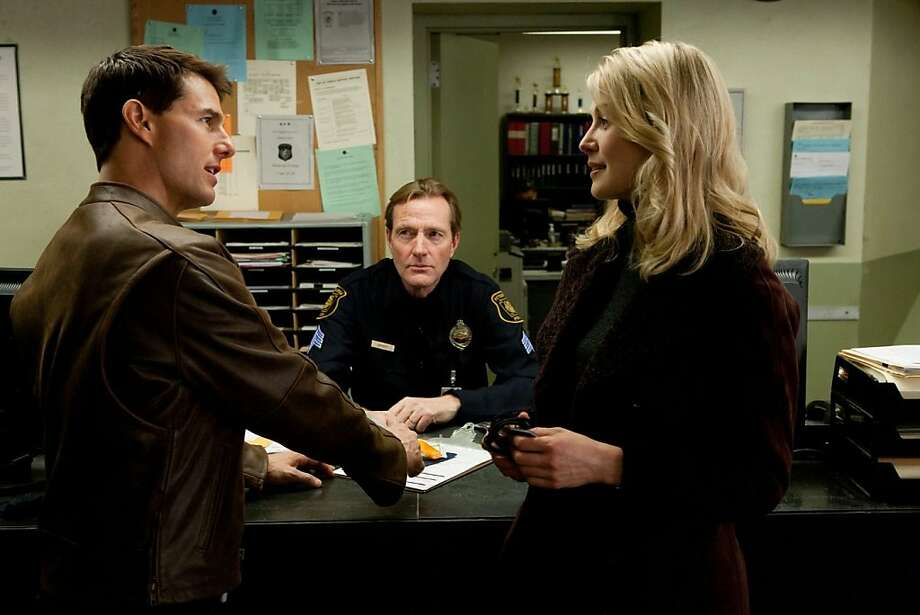 "Rosamund Pike (right) and Tom Cruise in ""Jack Reacher""; he's a vigilante, she's a lawyer who's not on his side - yet. Photo: Paramount"