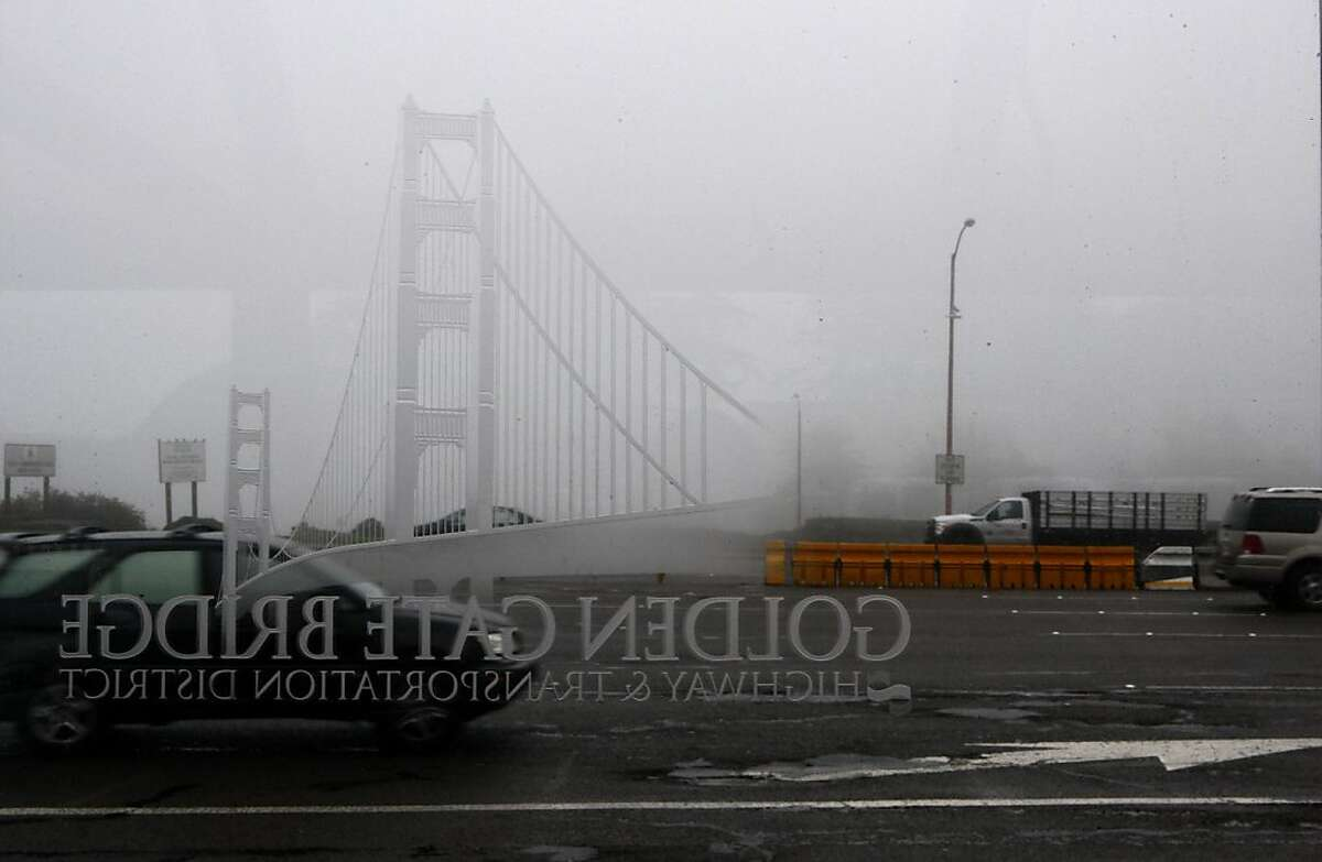 The dividers on Doyle Dr. (yellow) seen from a bus stop will replace the divider on Golden Gate bridge in San Francisco, Calif., on Wednesday, December 5, 2012.