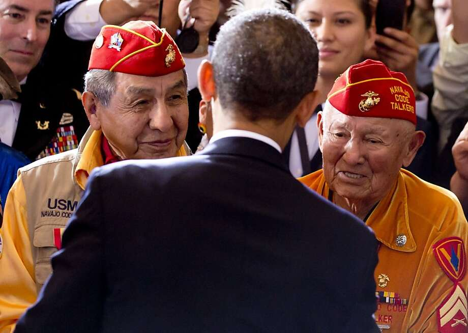 Peter MacDonald (left) and George James Sr., members of the Navajo Code Talkers during World War II, meet President Obama at the Tribal Nations Conference in Washington, D.C. Photo: Saul Loeb, AFP/Getty Images
