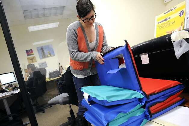 Nicole Hanks of the Center for Environmental Health with children's mats that contain high chemical levels. Photo: Michael Short, Special To The Chronicle / SF