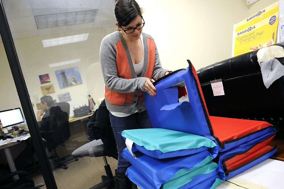 Nicole Hanks of the Center for Environmental Health with children's mats that contain high chemical levels. Photo: Michael Short, Special To The Chronicle
