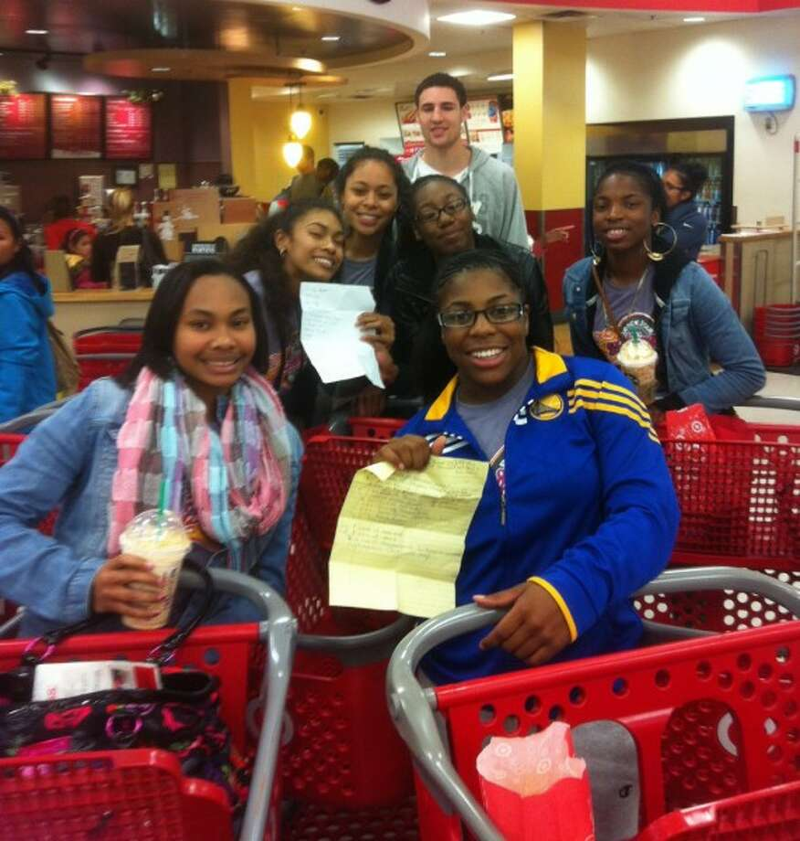 Before Thanksgiving, Golden State Warrior Klay Thompson joined the Good Tidings Foundation to help the Eastside College Preparatory School girls' basketball team buy food and equipment. Thompson picked up the students in a limo and took them to Target for Thanksgiving dinner supplies and then to Sports Authority for new pairs of shoes. (Golden State Warriors / Courtesy)