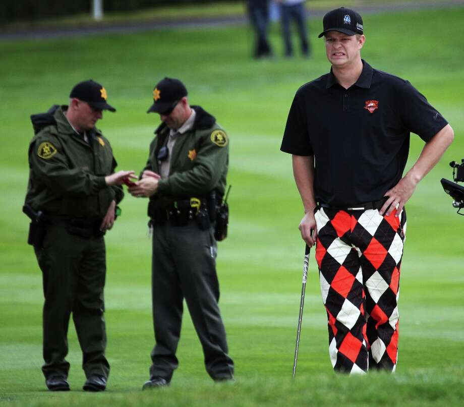 San Francisco Giants pitcher Matt Cain may not look pleased, but he's wearing those pants for the charity shootout between the San Francisco 49ers and the Giants at the AT&T Pebble Beach National Pro-Am golf tournament. Photo: Lance Iversen, The Chronicle / ONLINE_YES
