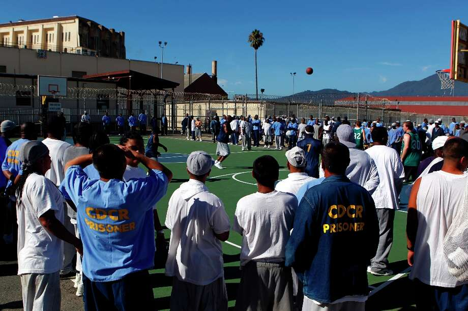 Inmates watch the basketball game between employees of the Golden State Warriors organization and the San Quentin Warriors at San Quentin State Prison on Saturday, Sept. 22, 2012. Photo: Paul Chinn, The Chronicle / ONLINE_YES