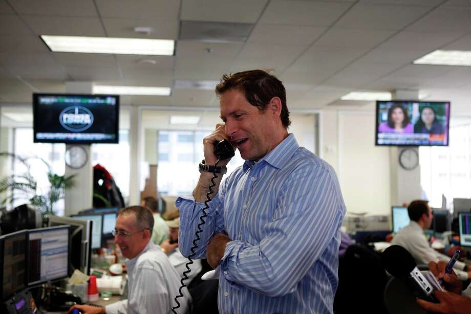 Former San Francisco 49er quarterback Steve Young talks on the phone to a client at the BTIG LLC offices during their Commissions for Charity Day in San Francisco, Calif. on Thursday May 6, 2010. The firm's last Commissions for Charity Day raised more than $3 million. Photo: Lea Suzuki, The Chronicle / SFC