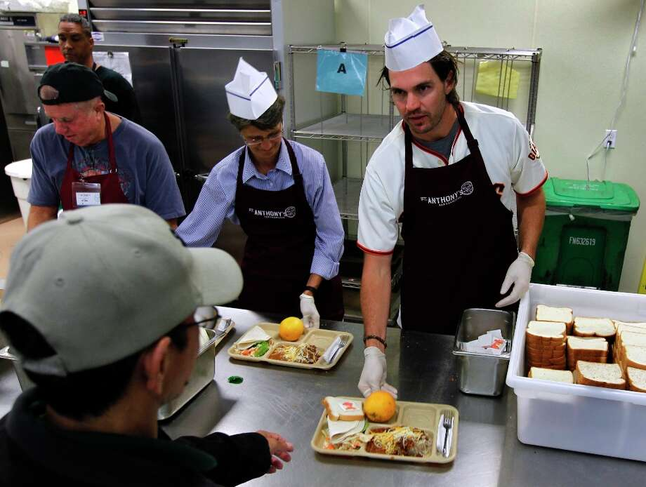 Giants pitcher Barry Zito serves a meal to a diner at the temporary location of the St. Anthony's Dining Room. Photo: Paul Chinn, The Chronicle / ONLINE_YES