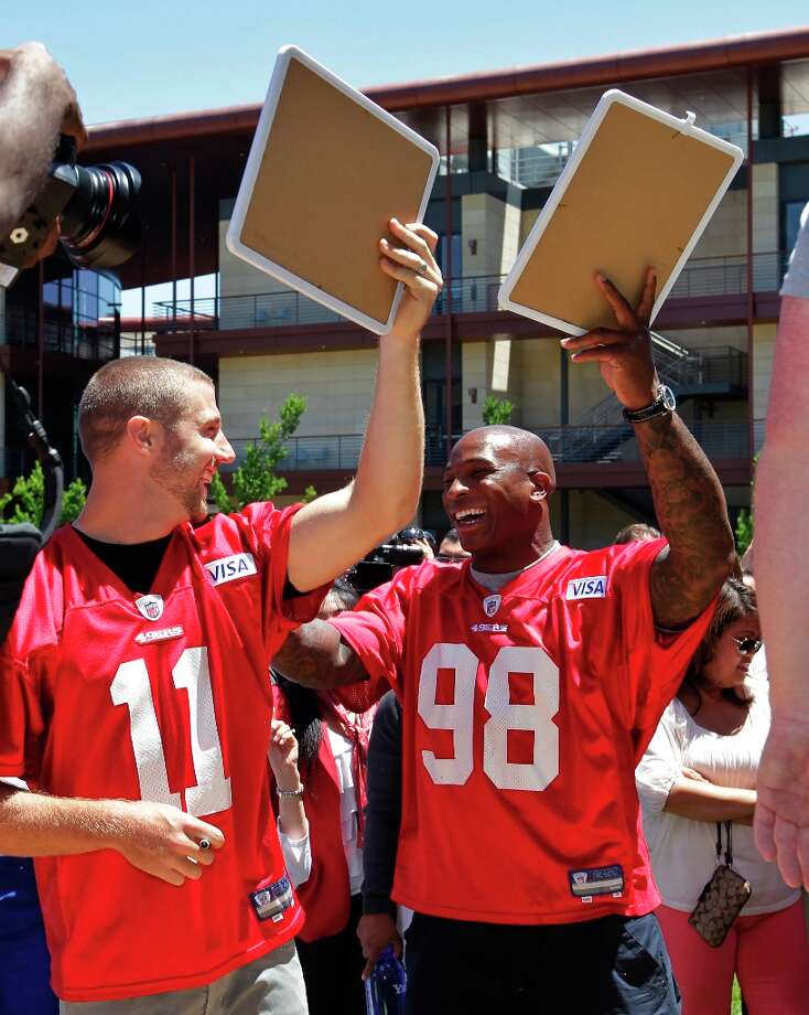 Alex Smith and linebacker Parys Haralson celebrate after they helped count push-ups by Stanford University Center medical staffers during the annual Stanford Push Up Challenge on the Stanford, Calif., campus, Friday, June 8, 2012. The event helps brings awareness for heart disease research on campus. Photo: Paul Sakuma, Associated Press / AP