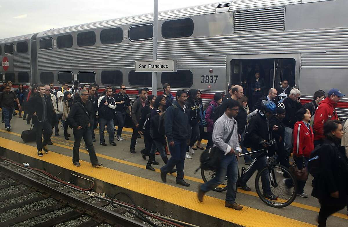 Commuters arrive at the Caltrain station at 4th and King streets in San Francisco, Calif. on Tuesday, Dec. 4, 2012. Caltrain still doesn't offer wifi access on board despite repeated requests from regular passengers.