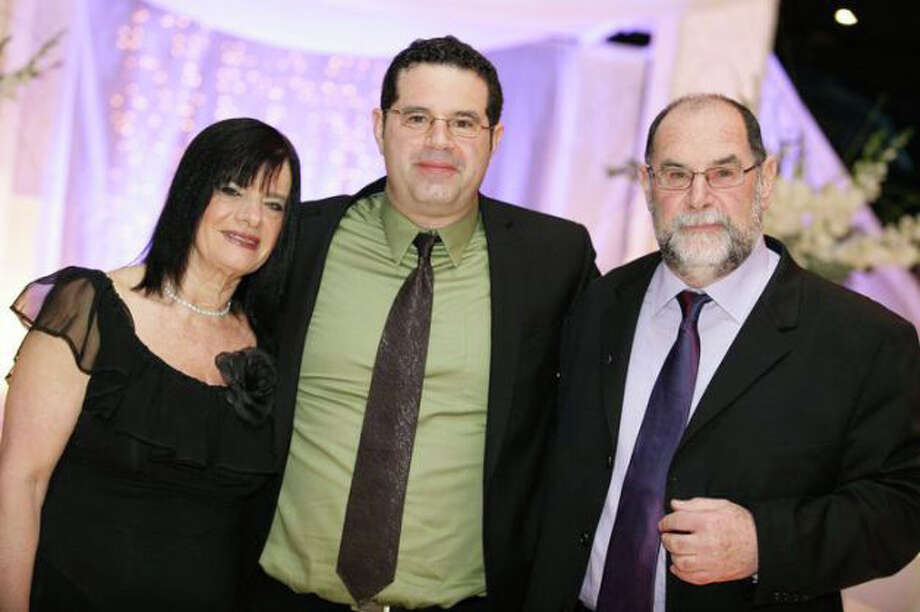 "A picture of the Zeevi family. From right, are: Yekutiel ""Kuti"" Zeevi; Yekutiel Zeevi's son, Neer Zeevi; and Yekutiel Zeevi's wife, Nava Zeevi. Photo: Contributed Photo / Westport News contributed"