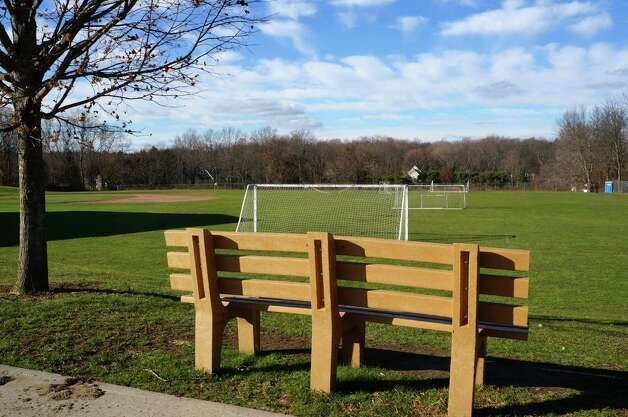 "This bench at the Long Lots Elementary School playing field was donated in honor of the late Yekutiel ""Kuti"" Zeevi by his recreational soccer teammates. Zeevi played regularly at the Long Lots field. Photo: Paul Schott / Westport News"