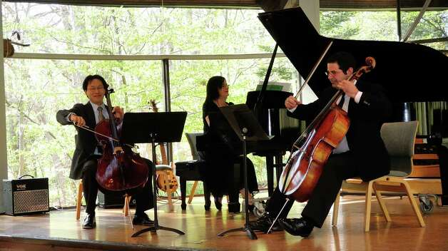 "Neer Zeevi, right; Nava Zeevi, at piano; and Kenneth Kuo, a friend of the Zeevi family, performed in April at a memorial concert for Yekutiel ""Kuti"" Zeevi, held at the Unitarian Church in Westport. Photo: Contributed Photo / Westport News contributed"