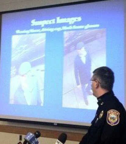 Westport Police Chief Dale Call showed images of the suspect in the killing of Yekutiel Zeevi during a December 2011 press conference. Photo: Paul Schott / Westport News