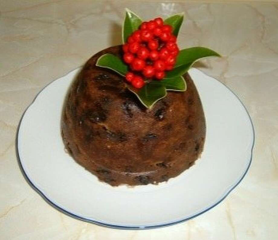 Britain: Stirring the Christmas PuddingIn Britain, the Christmas Pudding, also called plum pudding, is a big deal. Many families have their own recipes that go back generations. The puddings are almost black, thanks to the long cooking time and the dark sugar, and are moistened with juice or brandy. Usually, you make the pudding at least four or five weeks before Christmas, and it can last up to a year. Traditionally, every member of the household stirs the pudding while making a wish. When it's time to serve the pudding, tradition calls for bathing it in brandy and setting it on fire.