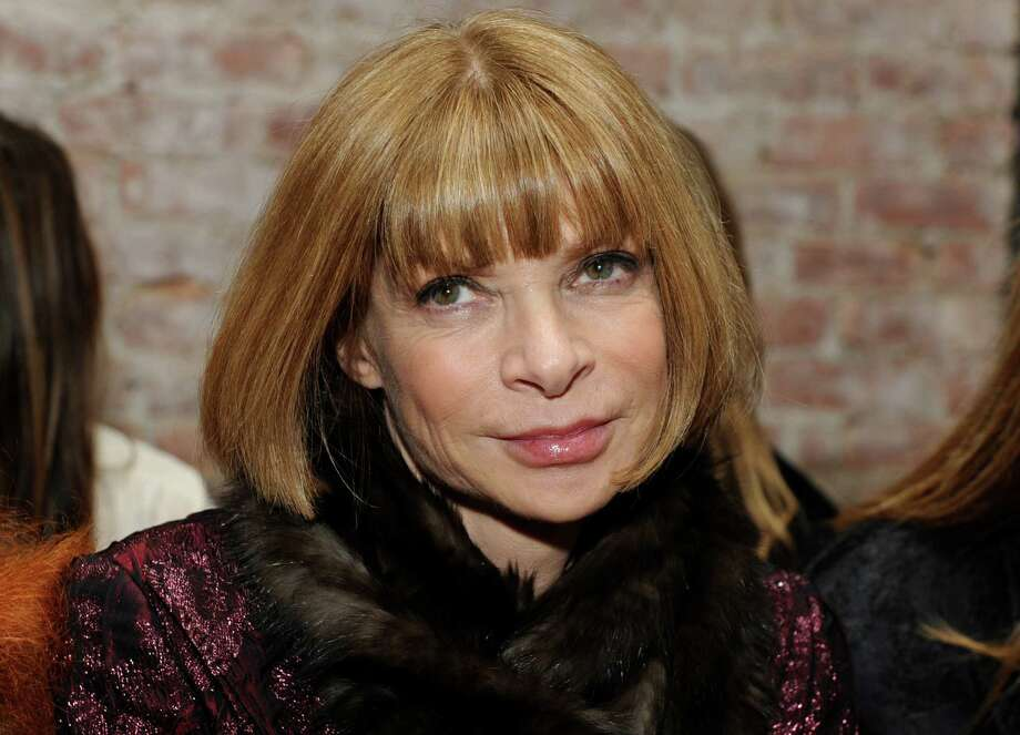 FILE - This Friday, Feb. 12, 2010 photo shows Vogue Editor-in-Chief Anna Wintour before the start of the Rag & Bone fall 2010 collection during Fashion Week in New York. Anna Wintour may be poised to follow in the footsteps of Thomas Jefferson, Ben Franklin and John Quincy Adams by becoming U.S. ambassador to England or France. Officials at the U.S. Embassy in London said they would not speculate on President Obama?s eventual choice for a successor to Ambassador Louis Susman, who has announced plans to step down. (AP Photo/Diane Bondareff, file) Photo: Diane Bondareff, FRE / FR81453 AP