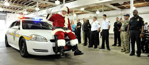 Santa Claus arrives on the front of a Jacksonville Sheriffs Office patrol car for the 64th annual Fraternal Order of Police Christmas party for special needs children in the Duval County Public School was held at the Jacksonville Fair Grounds on Wednesday, Dec. 5, 2012, in Jacksonville, Fla. Photo: Bruce Lipsky, Associated Press / Florida Times-Union