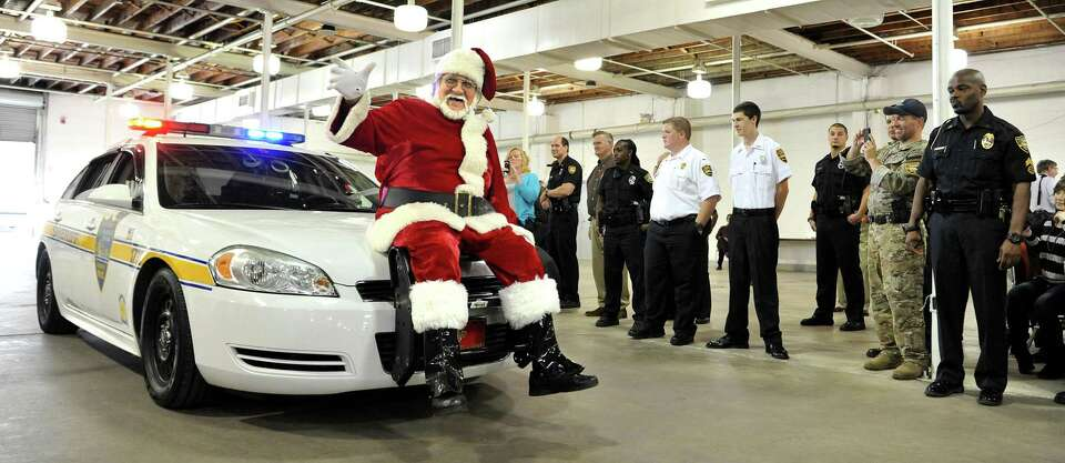 Santa Claus arrives on the front of a Jacksonville Sheriffs Office patrol car for the 64th annual Fr