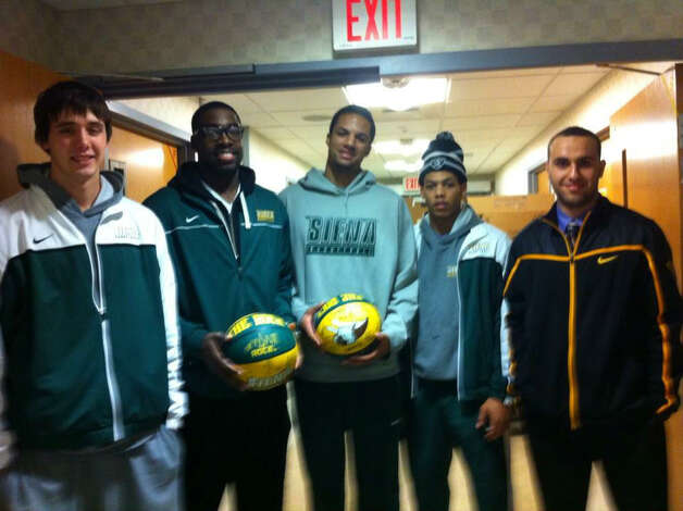 Siena players Brett Bisping, O.D. Anosike, Davis Martens, Chris Leppanen as well as student Farshad Sarrafi-Nour visited the high school students injured in the Northway accident that killed two of their friends. (From the Siena athletics Twitter feed)