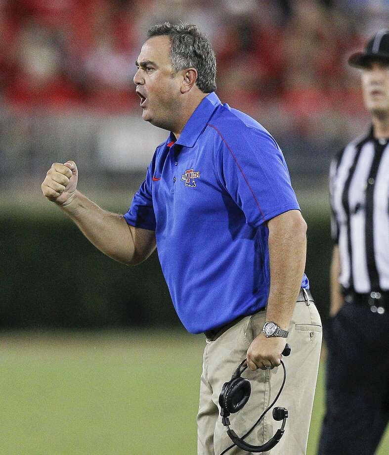 HOUSTON, TX - SEPTEMBER 08: Head coach Sonny Dykes cheers on his team after a defensive stop against the Houston Cougars at Robertson Stadium on September 8, 2012 in Houston, Texas. Louisiana Tech Bulldogs defeated the Houston Cougars 56-49. (Photo by Bob Levey/Getty Images) Photo: Bob Levey, Getty Images