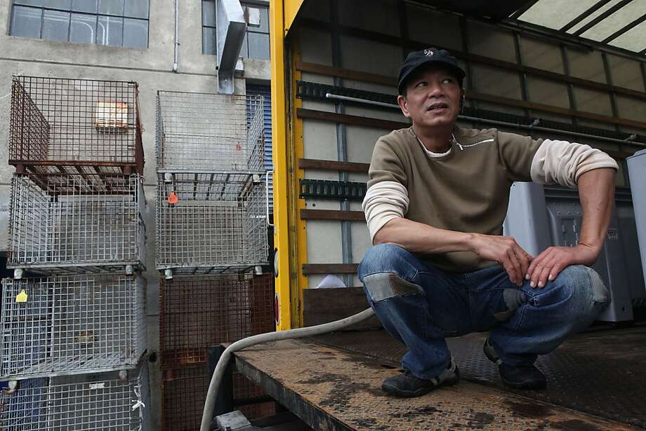 Seafood wholesaler Don Nguyen of Goldstar loading his truck with salt water at Fisherman's Wharf in San Francisco, Calif., for his warehouse in South San Francisco on Wednesday,  December 5, 2012.  He said last week he was able to access 10,000 pounds of crab but hasn't had any this week because of the storms. Photo: Liz Hafalia, The Chronicle