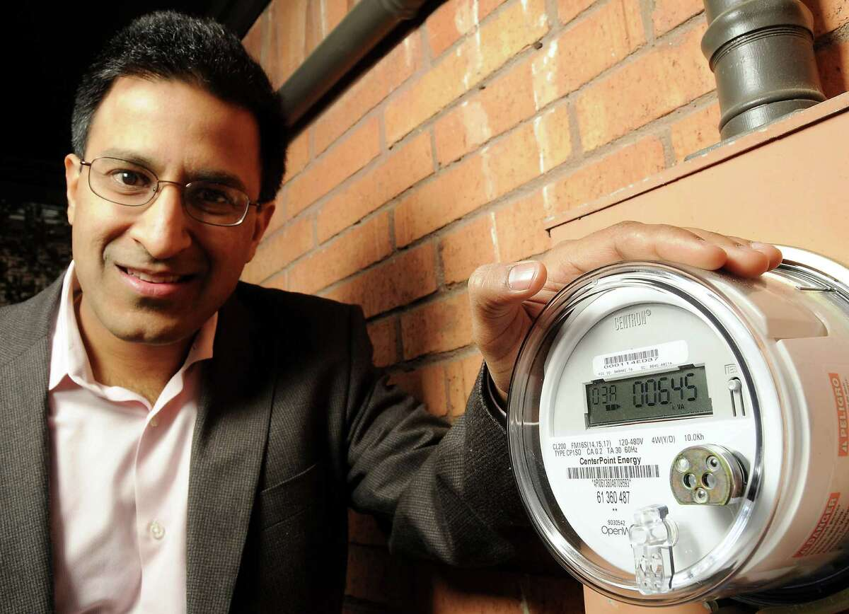 Rakesh Agrawal with the new smart meter on his home Friday Feb. 05,2010.(Dave Rossman Photo)