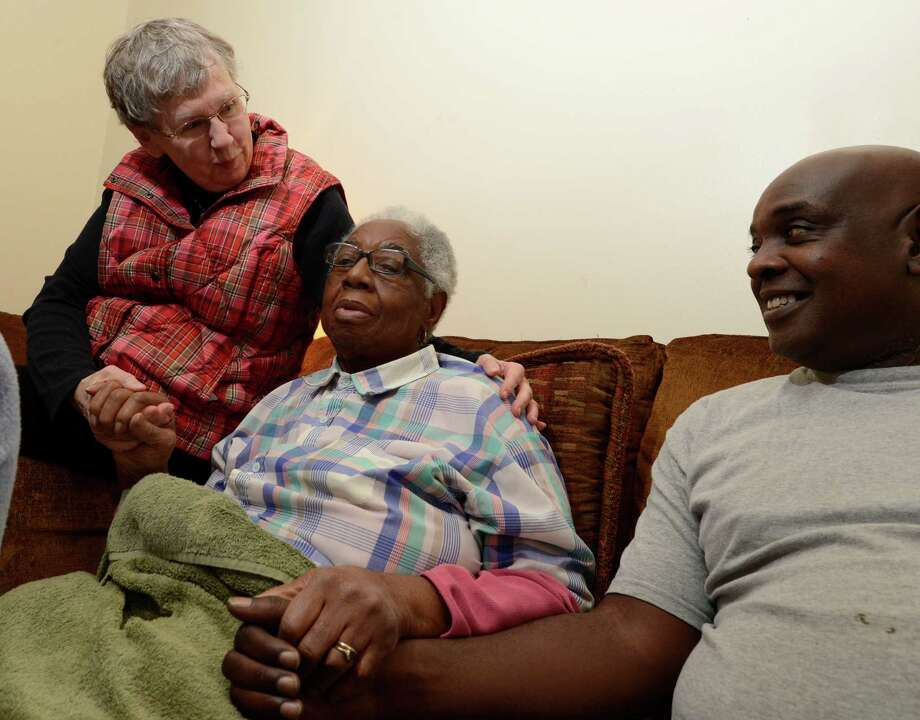 Deacon Lois Wilson of the Westminster Presbyterian Church, left sits with great grandmother Clara Hankins and her nephew Ervin Ashburn as they discuss domestic violence Dec 4, 2012,  after loosing their loved on Tonette Thomas earlier in the week in Albany, N.Y. (Skip Dickstein/Times Union) Photo: Skip Dickstein / 00020350A