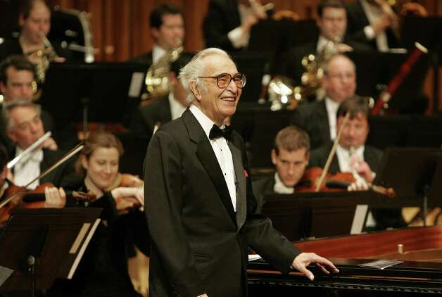 FILE - This Dec. 6, 2005 file photo shows jazz pianist Dave Brubeck at his piano as he celebrates his 85th birthday on stage at London's Barbican Hall after a performance with the London Symphony Orchestra. Brubeck, a pioneering jazz composer and pianist died Wednesday, Dec. 5, 2012 of heart failure, after being stricken while on his way to a cardiology appointment with his son. He would have turned 92 on Thursday. (AP Photo/Alastair Grant, file) Photo: ALASTAIR GRANT