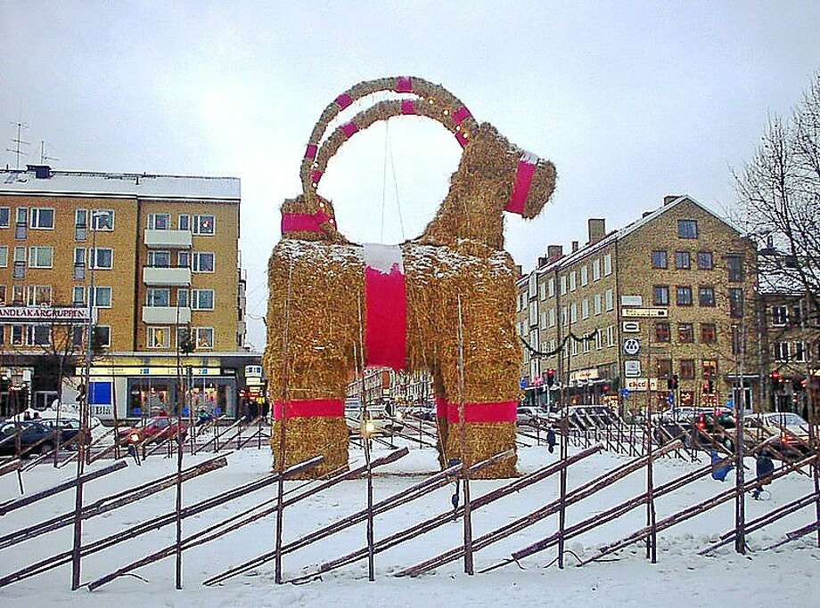 "Sweden: Christmas Straw GoatsChristmas goats have a big role in Swedish Christmas celebrations from small ornaments to gigantic goats like this one in the city of Gavle that is set up every year in December. The big Gavle goat is famous for being vandalized or burnt down frequently. Since 1966, the Straw Goat has survived until Christmas Day only 13 times. The arsonists succeeded in 2012, burning the goat to the ground on December 12. This year, you can follow the Goat's Twitter page for updates on its ""struggle to survive."" Photo: Photo Taken By Christian Gidl F"