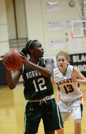 Norwalk's Emma Oyomba (12) controls the ball as Stamford's Maxine Fodiman (13) defends during the girls basketball game at Stamford High School on Wednesday, Dec. 5, 2012. Photo: Amy Mortensen / Connecticut Post Freelance