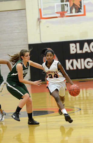 Stamford's Tiana England (24) controls the ball as Norwalk's Alex Weber (32) defends during the girls basketball game at Stamford High School on Wednesday, Dec. 5, 2012. Photo: Amy Mortensen / Connecticut Post Freelance