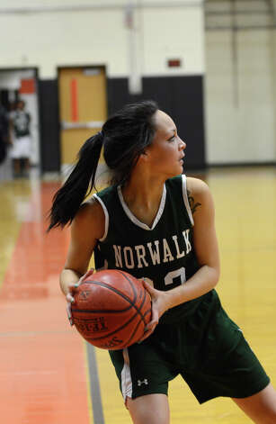 Norwalk's Shayna Bowers (22) controls the ball during the girls basketball game against Stamford at Stamford High School on Wednesday, Dec. 5, 2012. Photo: Amy Mortensen / Connecticut Post Freelance