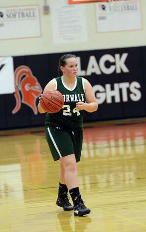 Norwalk's Mallory Rochefort (24) controls the ball during the girls basketball game against Stamford at Stamford High School on Wednesday, Dec. 5, 2012. Photo: Amy Mortensen / Connecticut Post Freelance