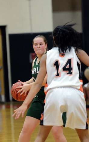 Norwalk's Mallory Rochefort (24) looks to pass as Stamford's Briana Gordon (14) defends during the girls basketball game against Stamford at Stamford High School on Wednesday, Dec. 5, 2012. Photo: Amy Mortensen / Connecticut Post Freelance