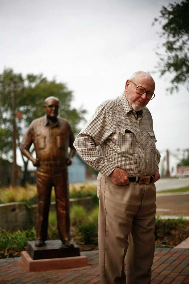 "Hilmar Moore stands in front of a statue of himself in downtown Richmond that was dedicated earlier this year.  ""Not one dime of tax dollars went towards it,"" Moore said of the statue funded entirely by private donations. Photo: Michael Paulsen, Houston Chronicle / Houston Chronicle"
