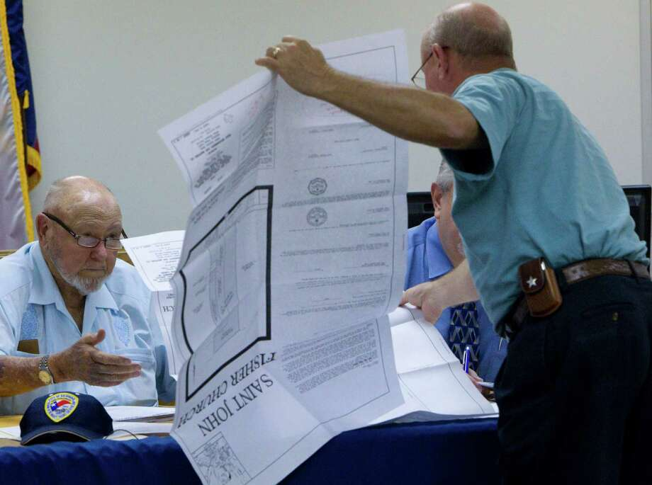 Considered to be the longest-serving mayor, Hilmar Moore, 90, who took office in 1949, goes over a construction bid with City Engineer Richard Stolleis of Kelly Kaluza and Associates Monday, Aug. 16, 2010, in Richmond. Photo: Johnny Hanson, Houston Chronicle / Houston Chronicle