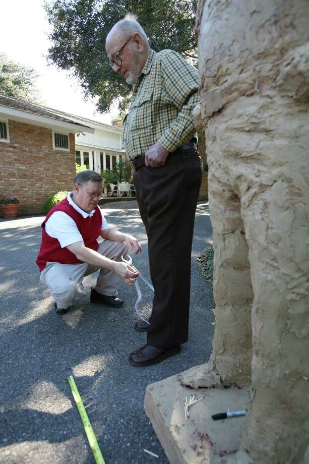 Sugar Land sculptor Bob Pack uses a tool to measure the ankles of Richmond Mayor Hilmar Moore for the life-size statue of Moore that Pack is creating. Photo: Suzanne Rehak, For The Chronicle / Freelance