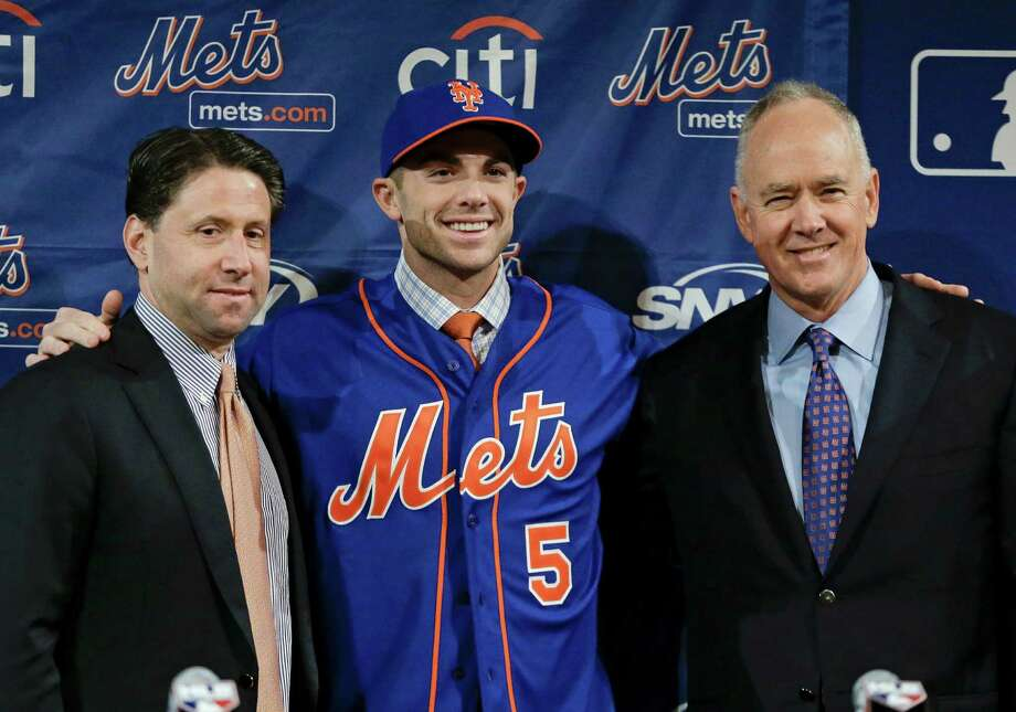 New York Mets third baseman David Wright poses for photos at a news conference where it was announced that he has signed a contract extension with the team through 2020 at the baseball winter meetings on Wednesday, Dec. 5, 2012, in Nashville, Tenn. From left are Mets chief operating officer Jeff Wilpon, Wright, and general manager Sandy Alderson. (AP Photo/Mark Humphrey) Photo: Mark Humphrey