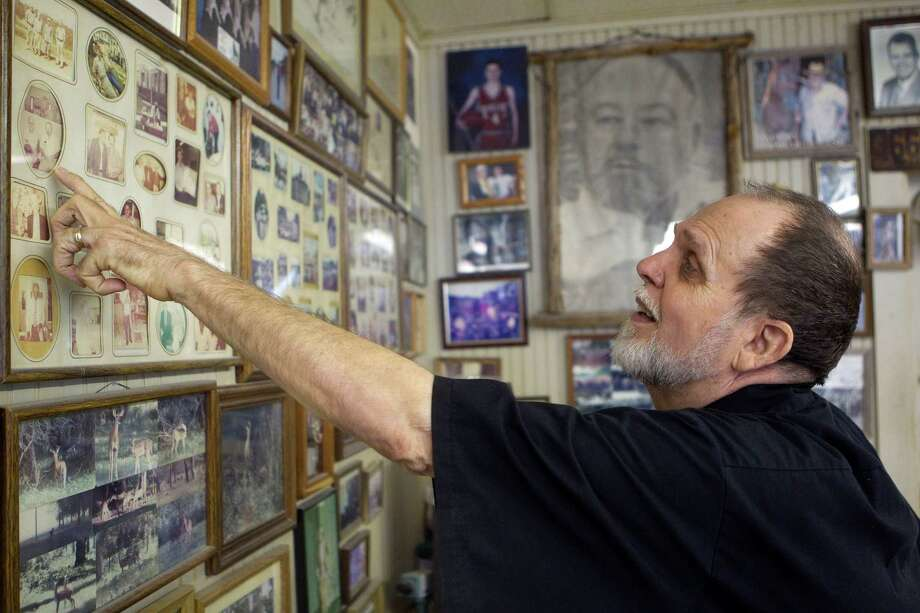 Next to a large picture of Richmond Mayor Hilmar Moore, A.D. Eversole, the owner of the Richmond Barber Shop points to images of Hilmar as he spoke fondly of his long-time friend and customer who died of natural causes Tuesday at age 92. Photo: Johnny Hanson, Houston Chronicle / © 2012  Houston Chronicle
