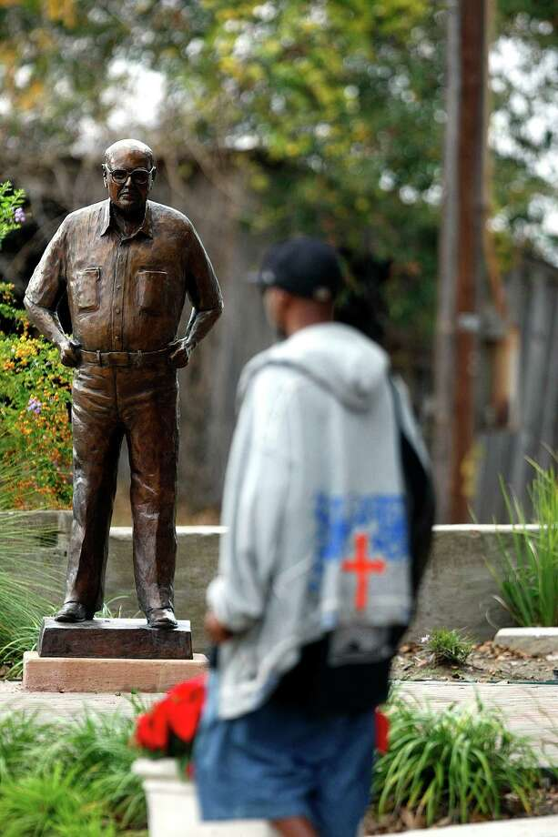 Jarek Bradshaw walks past the stature of Richmond Mayor Hilmar Moore, one of the longest serving mayors in the United States, who died of natural causes Tuesday at age 92, a family member confirmed. Photo: Johnny Hanson, Houston Chronicle / © 2012  Houston Chronicle