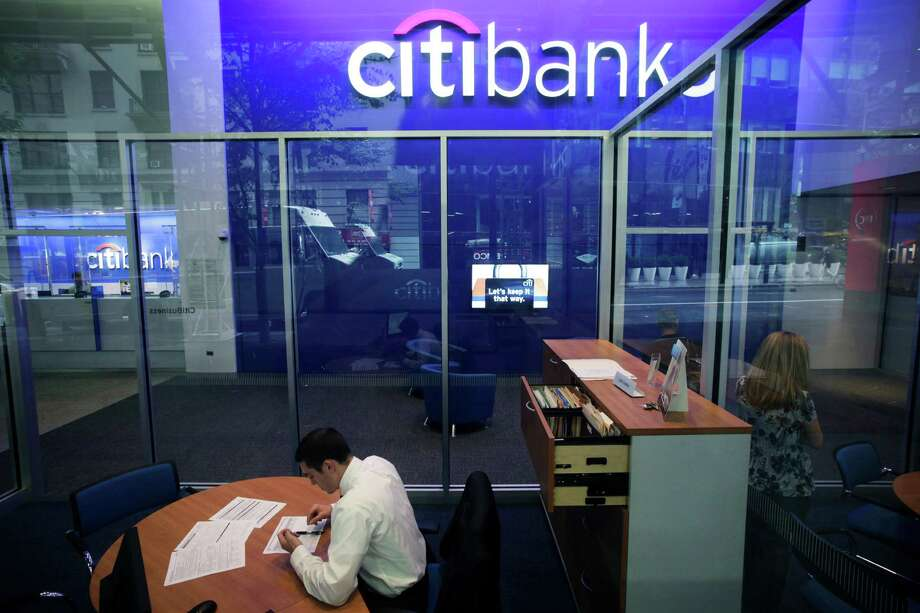 FILE - This Oct. 13, 2011 file photo, shows a Citibank branch in New York.  Citigroup said Wednesday, Dec. 5, 2012, that it will cut 11,000 jobs, a bold early move by new CEO Michael Corbat. The cuts amount to about 4 percent of Citi's workforce of 262,000.  The bulk of the cuts, about 6,200, will come from Citi's consumer banking unit, which handles everyday functions like branches and checking accounts.  (AP Photo/Mark Lennihan, File) Photo: Mark Lennihan