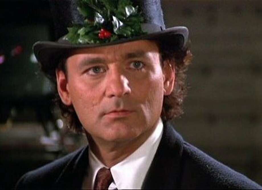 """""""Scrooged"""" -- This is Bill Murray at his Scroogy best, but Carol Kane as the Ghost of Christmas Present steals the show. Photo: Paramount Pictures 1988"""